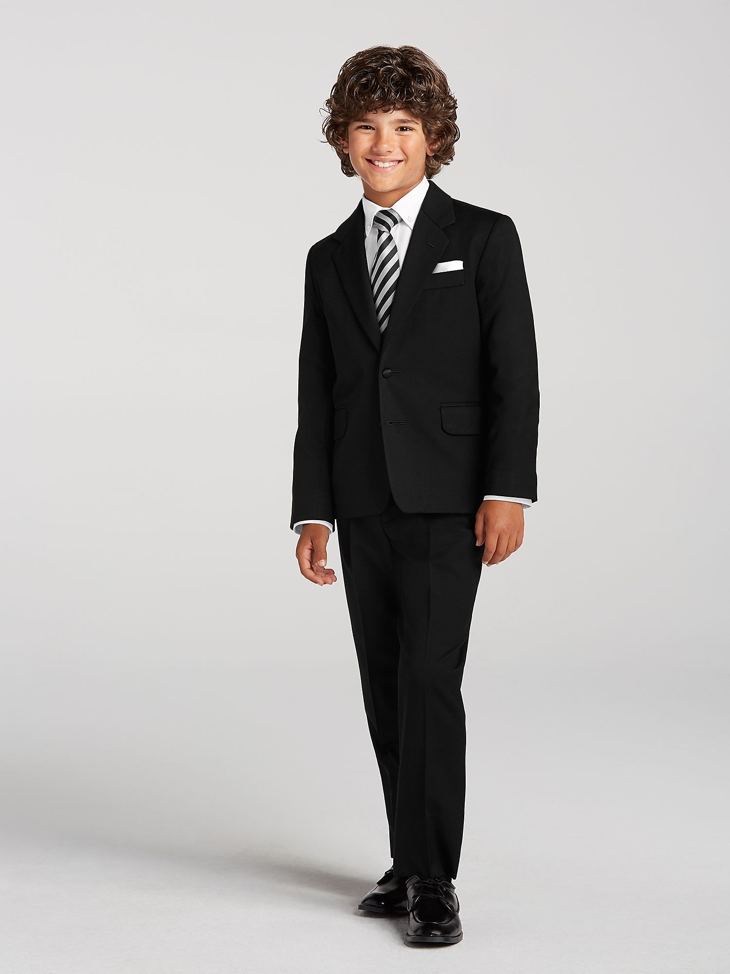 BlackNBianco includes a wide selection of boys suits and tuxedos, including different colors like White, Ivory, Brown, and Navy. Plus different styles like the traditional tuxedo with the tail, pinstripes, vest suits, and textured. We also have a beautiful selection of shirts to wear with any boys suits or tuxedos.